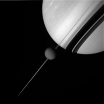A picture of Saturn and Titan shot by the Cassini spacecraft from a distance of  miles  kilometers from Titan