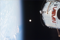 A picture of the Earth Moon and the Hubble Space Telescope shot by the crew of Space Shuttle Discovery