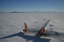 A plane lies abandoned slowly fading away into the Antarctic ice