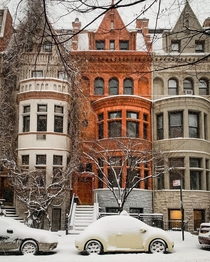 A pre-war Romanesque Revival brownstone in the snow Upper West Side Manhattan New York City