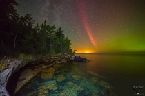 A proton arc a rare type of aurora appeared over lake Superior When massive amounts of protons bombards the Earths atmosphere following an energetic event on the Sun this kind of aurora is created