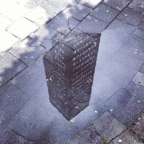 A puddle on the sidewalk in Leeuwarden the Netherlands