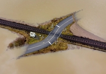 A railroad crossing is surrounded by flooding near Frankfurt Germany Michael Probst