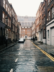 A rain-soaked street in east London  x