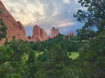A rainbow between two rock formations in Garden of the Gods Colorado