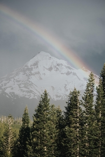 A rainbow formed over Mount Hood OR