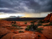 A rainstorm lit up by the setting sun at The Camelbacks aka The Vortex in Southern Utah