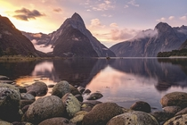 A rainy day that ended with one of my favorite sunsets ever Milford Sound New Zealand