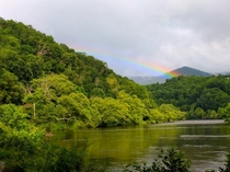 A rare rainbow shines through the stormy smoke in the aptly named Great Smoky Mountains National Park