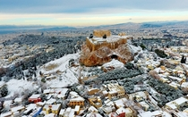A rare sight of Acropolis covered in snow caused by the recent European cold wave Athens Greece