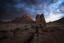 A rare stormy sunrise from this beautiful rocky somewhat barren place in the Namibian desert - Spitzkoppe