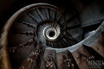 A rather nice staircase in an abandoned Insane Asylum