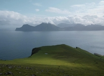 A ray of sunshine wandering over the cliffs of Gjgv Faroe Islands