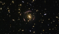 A real picture of an Einstein ring Light from the galaxy is distorted by a black hole