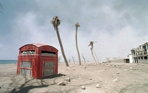 A red phone box lies half buried in volcanic ash in the abandoned city of Plymouth Montserrat