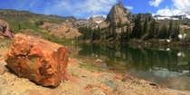 A red rock sits in front of Lake Blanche UT