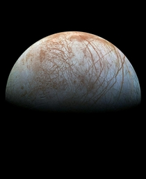 A remastered version of a picture showing Jupiters moon Europa taken by the Galileo spacecraft in the late s