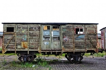 A Retired Wooden Train Car in Belgium  by Karin Counet