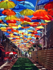 A roof of umbrellas over a courtyard in gueda Portugal