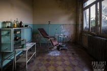 A rotting dentist chair in an abandoned orphanage in Italy x