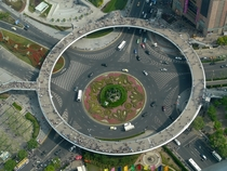 A roundabout in Lujiazui China that has a pedestrian bridge in the form of another raised roundabout