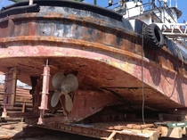A rusted out beached boat in Maine