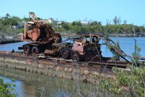 A rusting barge and crane in Hatchet Bay Eleuthera Bahamas