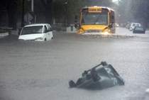 A school bus making waves on a flooded road in Norfolk Virginia Sept