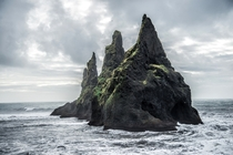 A sea stack off the coast of Iceland  Photographed by Romain Ribaud