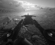 A shadow cast by NASAs Mars Rover Opportunity stretches across the Martian surface in this image from July   NASAAP