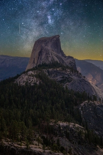A shooting star amp the Milky Way gleaming over Half Dome Yosemite National Park