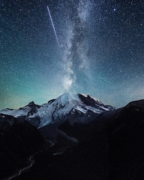 A shooting star over Mount Rainier  By Tanner Wendell Stewart