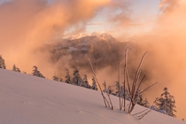 A shot through the clouds on Elk mountain in BC Canada x