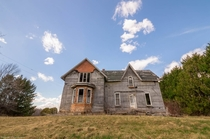 A simple abandoned house located on a rural back-road in Ontario Canada OC -