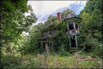 A small abandoned Manor house in South Wales slowly being re-claimed by nature after its occupants left
