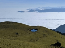 A small pond and a sea of clouds as a backdrop Mt Qilai East Ridge Taiwan