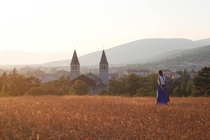 A small town in Bosnia - Girl walking into the sunset
