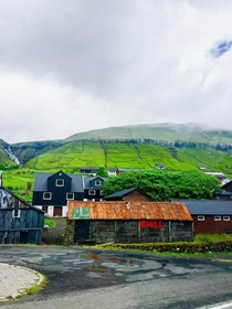 A small village in Iceland taken from a moving vehicle