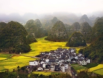 A small village surrounded by the hills of Guizhou Province China