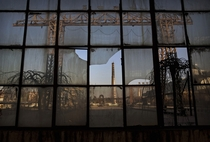 A smokestack is seen through a broken window of a building in the abandoned Qingquan Steel plant  one of several so-called zombie factories in Tangshan China Kevin Frayer