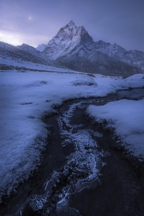 A snowy morning along the trail to Everest Base Camp I spent  days in Nepal trekking and this was probably my favorite day Enough snow had fallen the night before to stick on the landscape making for awesome conditions before it melted a few hours after s