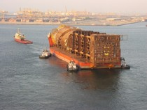 A spar platform being transported by a float onfloat off heavy lift vessel