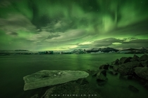 A spectacular night of Northern Lights above Icelands famous glacier lagoon Jkulsrln  Photo by Erez Marom xpost from rsland
