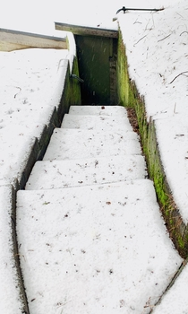 A staircase in the snow leading to an abandoned shed Crestline CA