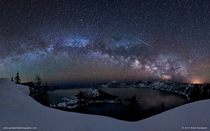 A starry night over Crater Lake Oregon USA  by Brad Goldpaint