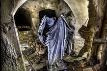 A statue in an abandoned crypt in Lithuania