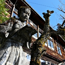 A statue of Niomiya Kinjiro standing in front of an abandoned junior school in the Nagano Prefecture Japan