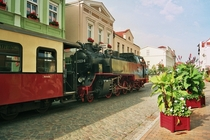 A steam train going down the street in Bad Doberan Germany