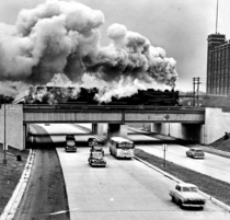 A steam train roars over Detroits John C Lodge Freeway in the s