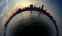 A stereographic panorama of Manhattans skyling shot from across the East River in Queens NY